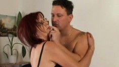 A redhead MILF gets her furry snatch filled up with stiff meat