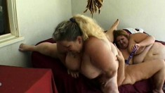 Massive lesbian bitches moan and scream during a heavy threesome
