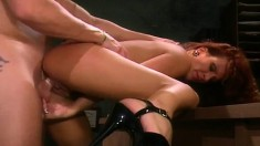 Hot redhead Heather rides a big pole before getting banged from behind