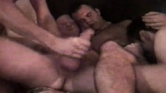 Four insatiable gay guys jerk and suck each other's dicks while in a motel