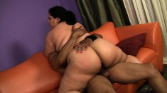 Luscious brunette plumper Karla Lane struggles with a large black pole