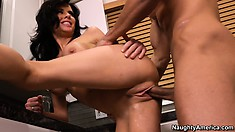 Brunette slut Veronica Avluv blows and gets banged in the kitchen