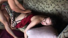Nasty brunette in fishnet stockings has a hung guy stretching her ass