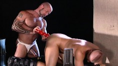Attractive hunk takes a red dildo and a stiff dick in his hungry ass