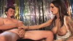 Tattooed brunette with big hooters Angelina Valentine gives a handjob