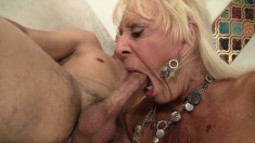 Huge breasted mature lady has a young stud drilling her aching pussy