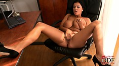 Busty Latina babe plays with her naked huge melons in the office