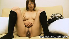 Asami gets undressed, shows off her tits and cunt, and gets fingered
