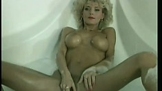 Vintage video of a blonde hussie masturbating in the bath tub