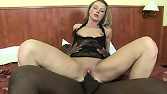 The sultry blonde lies on the bed and the black stud spoon fucks her hungry peach