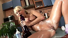 Ravishing young blonde Michelle has a huge black dildo taking her pussy to climax