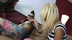 Inked up punk dyke gives a pretty blonde babe a rough banging