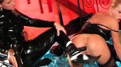 Latex lesbians eat and toy twats with some sexy sixty-nine thrown in