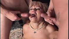 Two lusty and hung guys get off by fucking a horny busty granny