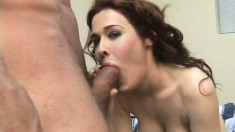 Luscious redhead milf with big tits has a stud fucking her hairy pussy