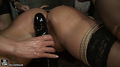 Kathia fingers her butt and sticks her black dildo in her wet cunt