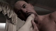 Submissive baldhead takes a foot and his Mistress's strap-on in his ass