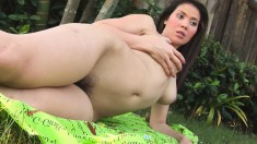 Dazzling girl Tina caresses her big boobs and displays her hairy peach