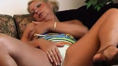 Big breasted blonde milf Rina gets naked and masturbates with a dildo