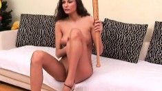 Sexy Lois Black poses and uses her fist and toy to fuck herself