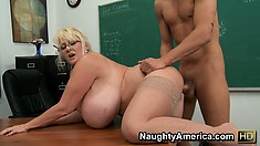 Kayla Kleevage uses her huge boobs to get her guy ready to fuck