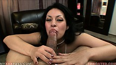 Busty babe with long black hair spreads her sexy legs and plays with her shaved twat