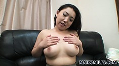 Alluring Asian milf with a pretty smile seductively exposes her marvelous big boobs