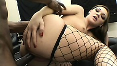 Two kinky babes in lingerie take turns feeding their hungry pussies a huge black rod