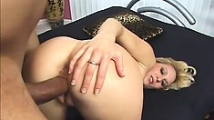 Irresistible blonde slut bends over to take in a black hunk's bone