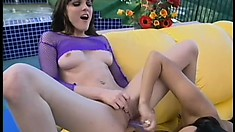 Two attractive brunettes have their tongues and fingers pleasing each other's twats