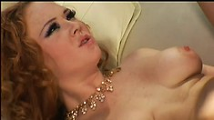 She bends over his car so he can fuck her ass and she plays with her toy