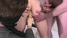 Two blindfolded guys get their asses drilled and their cocks stroked