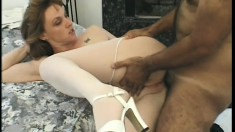 Horny blonde milf in white stockings has two guys fulfilling her needs