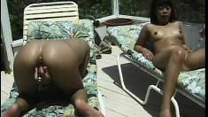 With the sun bathing her body, a beautiful Hawaiian girl pleases herself