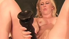 Horny blonde milf has a huge dildo and a black cock drilling her holes